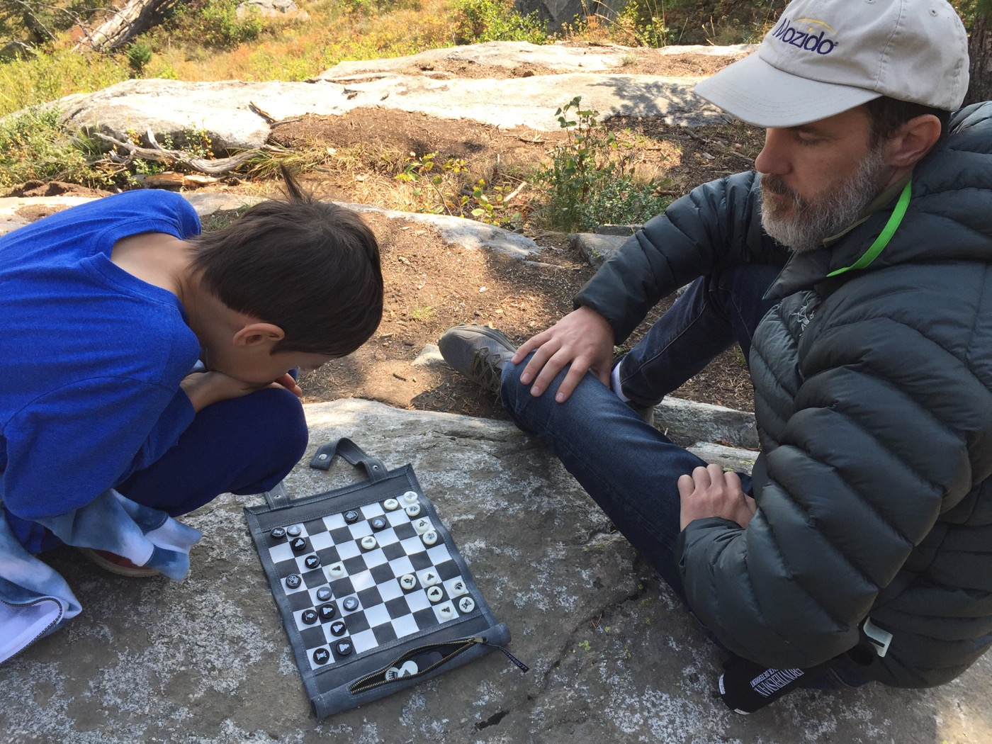 Kai and Ben playing chess, Tetons, Wyoming