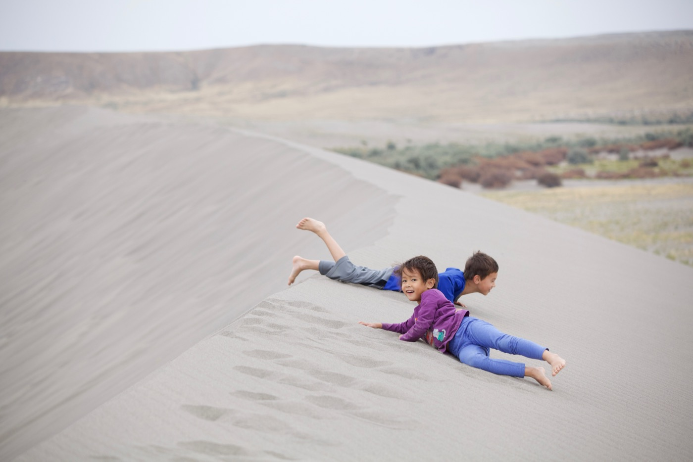 Heidi and Kai playing, Bruneau Sand Dunes