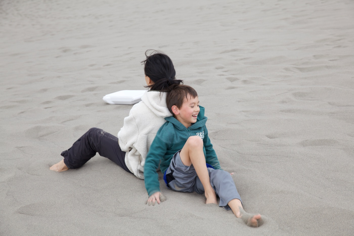 Kai trying to push Lily down the dune, Bruneau Sand Dunes, Idaho