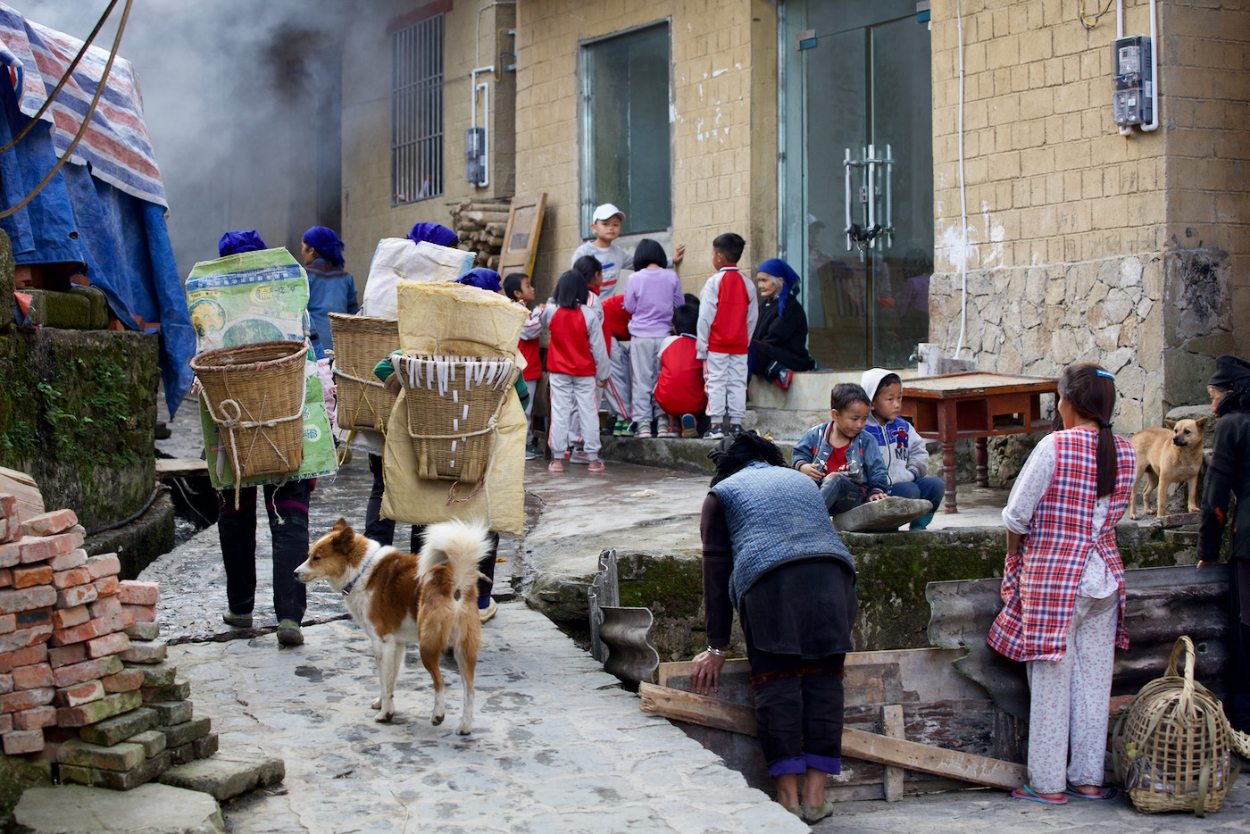 Always a lot of activity in the village. Duoyishu, Yunan, China
