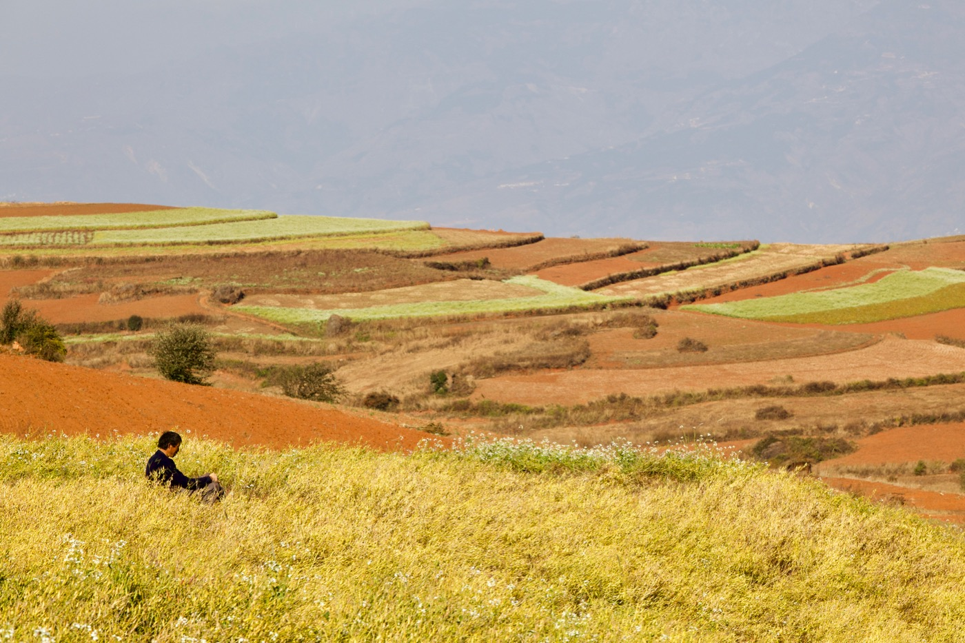 Farmer taking a rest.   Dongchuan, Yunnan, China