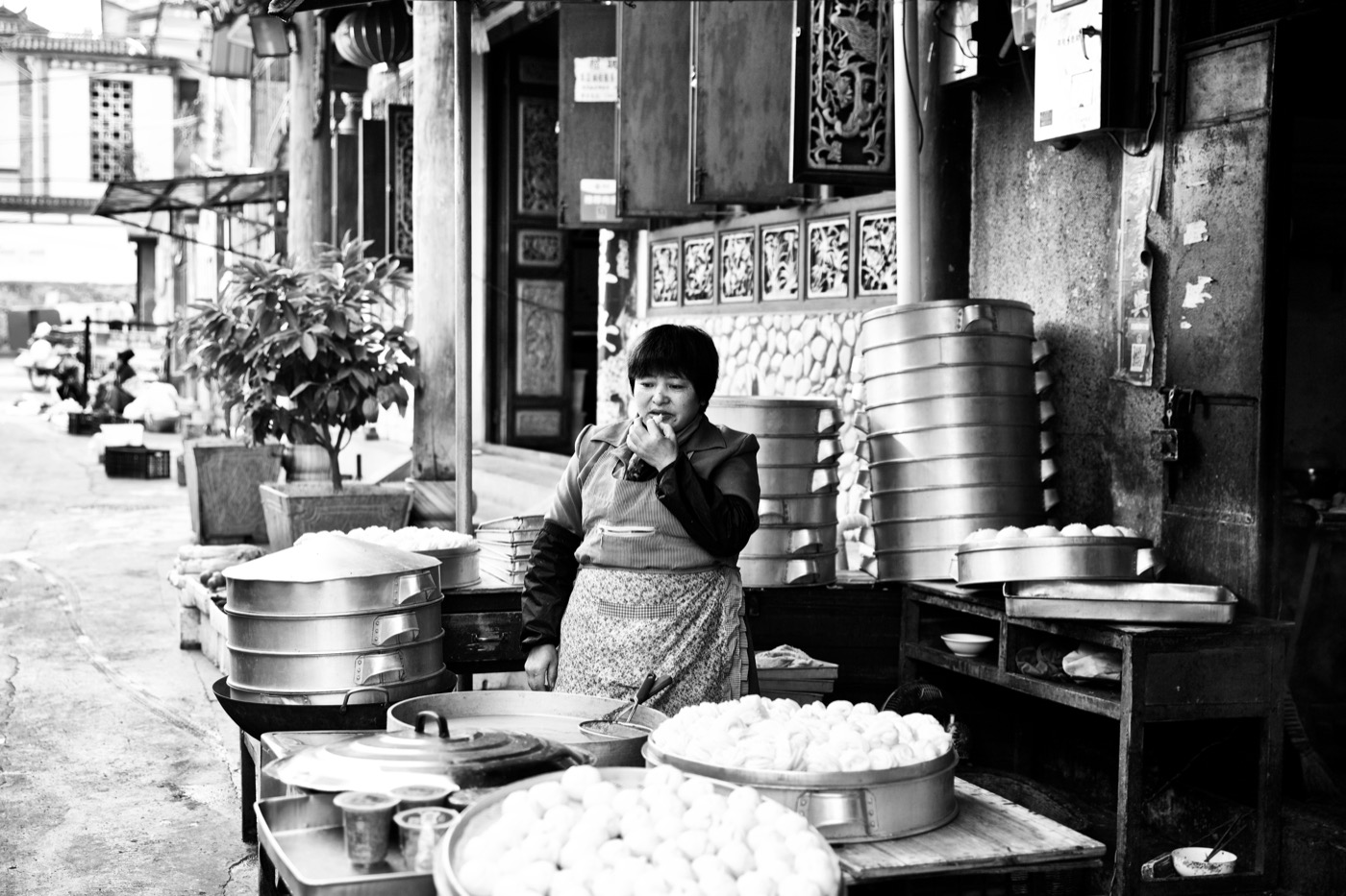Tasting the goods.  Dali, China