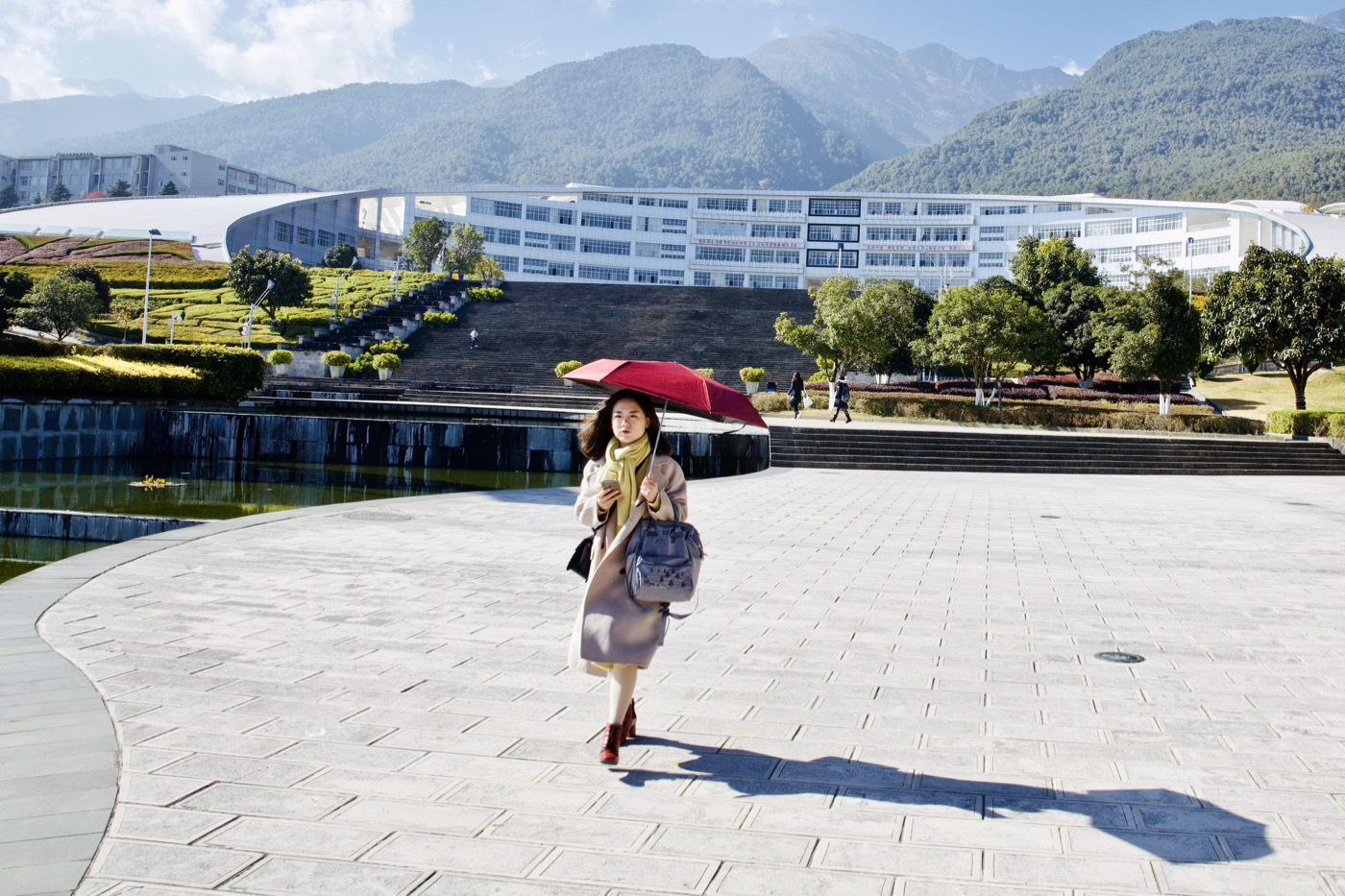 Lady with umbrella.  Dali University, Dali, China