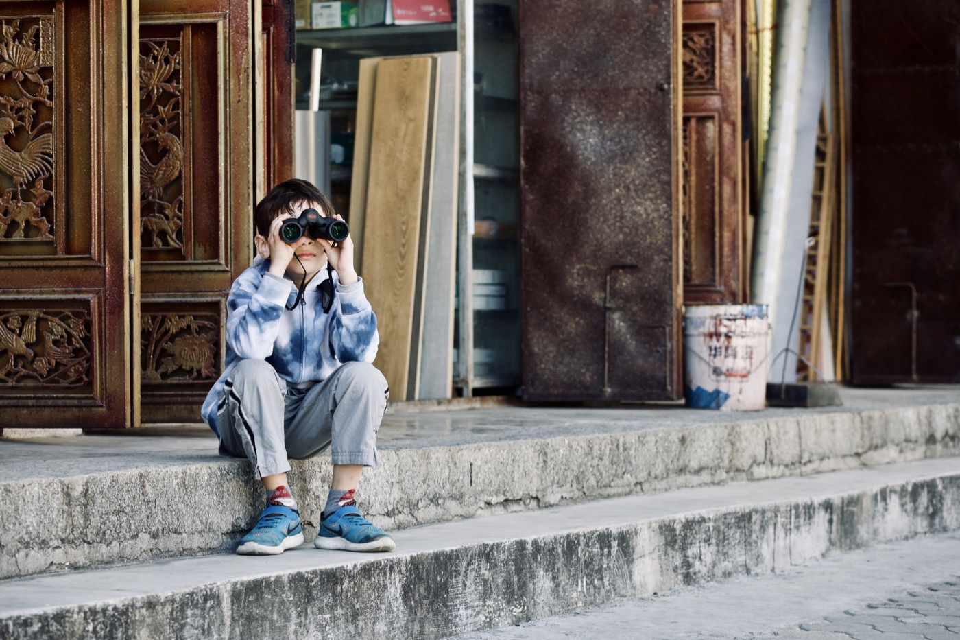 Kai on the lookout with his new binoculars.  Dali, China.