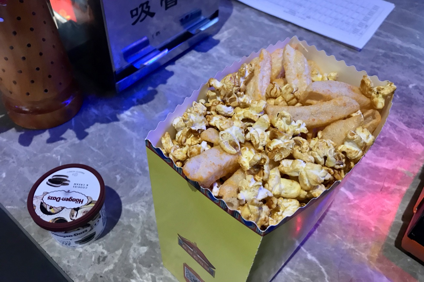 At the movies in Beijing.  Something has invaded my popcorn.