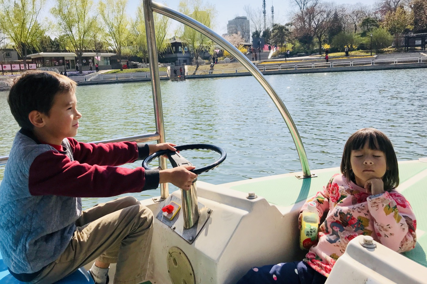 Kai and Heidi enjoying the park boats.  Beijing.